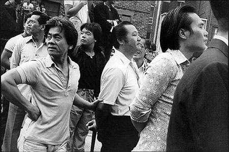 Men watching vollyball games in in Chinatown, Boston.