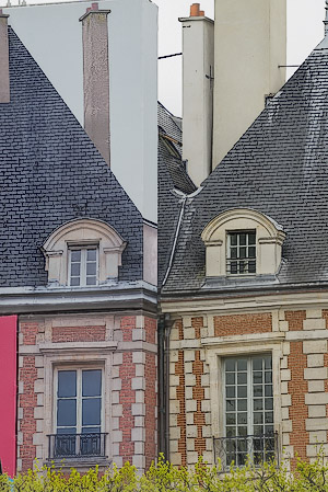 A classic mistake in white balance in a photograph printed far too blue and red in place des Vosges.
